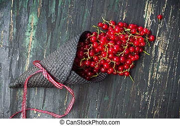 Currant fruit in an ice cream cone - Red currant fruit in an...