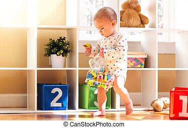 Toddler girl playing in her house