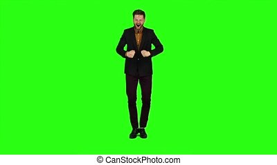 Guy ps he is rooting for his favorite team,. Green screen....