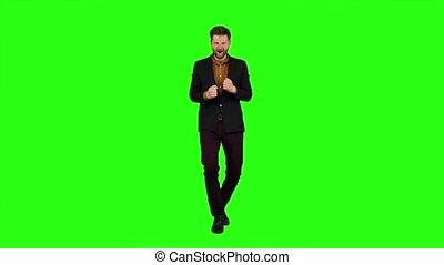 Man is dancing energetically, he is having fun. Green...