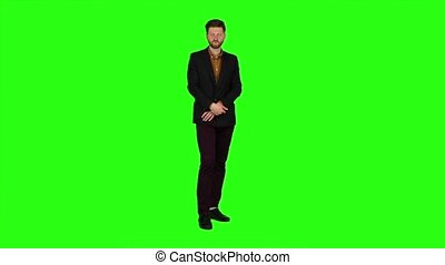Guy flirts, he smiles and builds his eyes. Green screen....