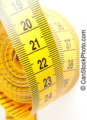 Yellow Measuring Tape - Roll of yellow measuring tape rolled...