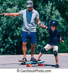 Grandfather and grandson skateboarding together