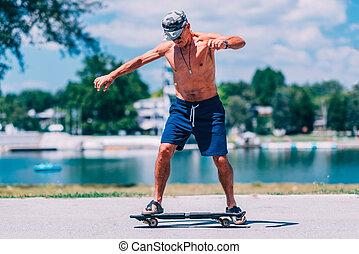 Senior male on skateboard
