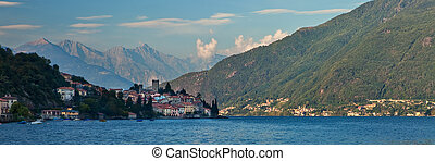 Lago di Como coastline town with mountains in background at...
