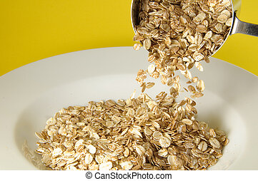 Granola Plate - Measuring cup pouring organic cereal on...