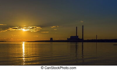 Sunset at power plant. Timelapse