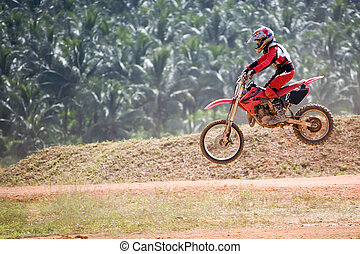 Motocross participant in action.