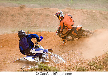 Motocross participants in action.