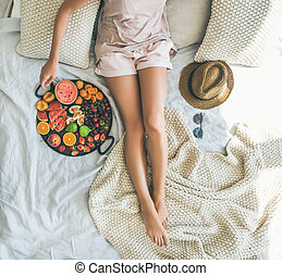 Summer healthy clean eating breakfast in bed concept, square...