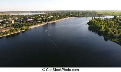 Aerial shot of the Dnipro quay with a modern road and...