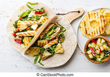 Mexican chicken tacos with grilled pineapple on white background