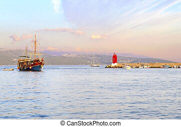 Krk town lighthouse, Croatia - The red lighthouse, mole at...