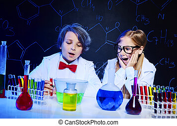 Shocked kids in the chemical laboratory