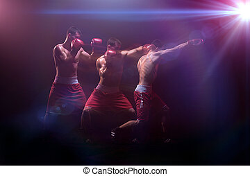 The boxer boxing in a dark studio - The male athlete boxer...
