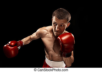 Male boxer boxing with dramatic edgy lighting in a dark...