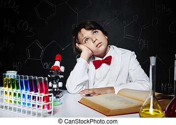 Dreaming little boy in laboratory