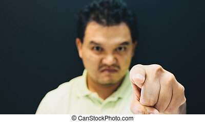 Asian man finger pointing with angry blame gesture - Asian...