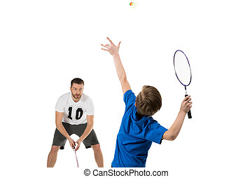 active father and son playing tennis together isolated on...