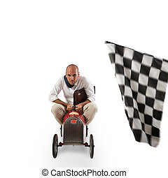 Successful businessman in a small car on the finishing line...