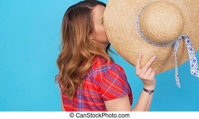Young woman with hat over blue background - Young woman...