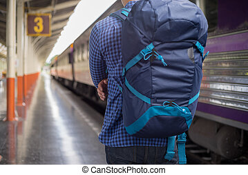 man traveler with backpacker at trainstation, travel concept