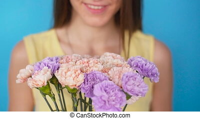 Beautiful woman with bouquet of Carnation