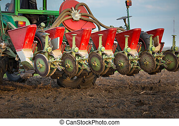 Seeder for sowing attached to tractor on soil - Close up of...