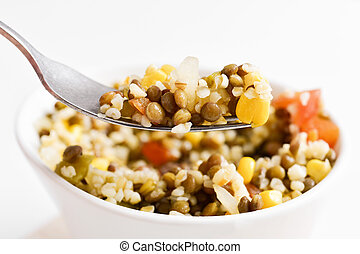 bulgur salad with lentils and other vegetables - closeup of...