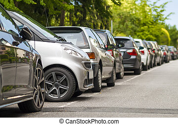 Rows of cars parked on the roadside in residential district....