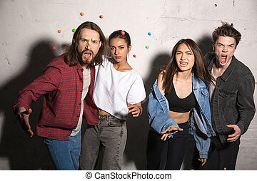 Angry hipsters loving couples scatter candies - Picture of...