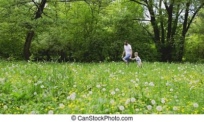 Young father with little boy in nature, sunny spring day. -...