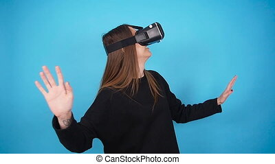 Young Woman using the virtual reality headset - Woman using...