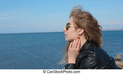 Close up portrait of woman in fashion trendy sunglasses...
