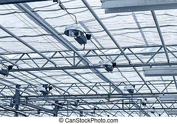 transparent roof inside greenhouse. structural glass ceiling.