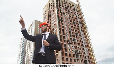 Engineer using gestures gives instructions at the...