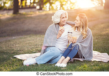 Intelligent woman enjoying conversation with old mother in...