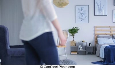 Woman walking in her modern bedroom movie