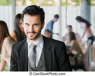 Happy businessman looking at the camera,office worker,business decisions