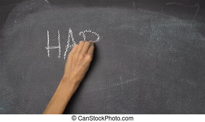 "Hand writing ""HAPPY VALENTINES"" on black chalkboard -..."