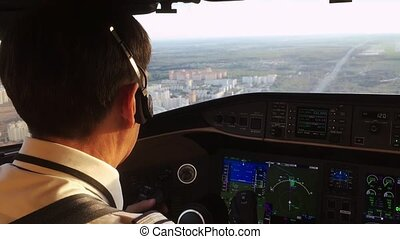 Captain in a cockpit operating the airplane