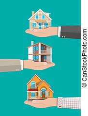 Businessman hand holding house. Real estate