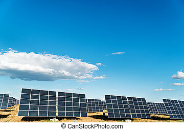 Solar power station - Solar power plant under a blue cloudy...