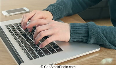 Male hands typing on laptop keyboard. Close up. Professional...