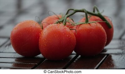 Drops of on ripe tomatoes. Close up.