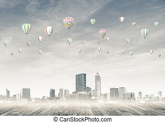 Concept of air pollution concept with aerostats flying above...