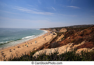 Blue sky over the farthest south end of Crystal Cove beach,...