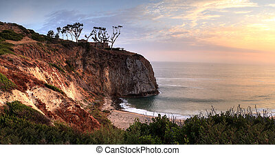 Sunset over the farthest south end of Crystal Cove beach,...