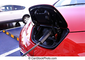 Electric car charging in electric station - Electric car...