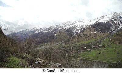 Snow peaks Mountains Kazbegi landscape in Georgia - Snow...